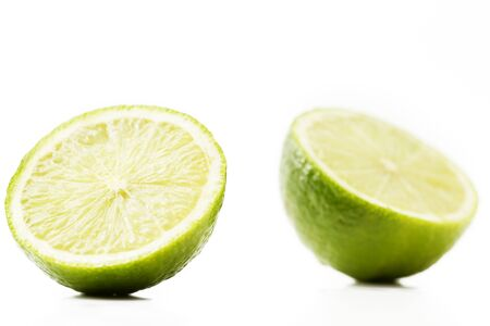 two and a half: two half limes on white background