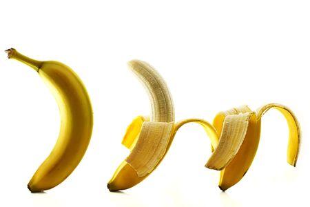 three bananas some peeled on white background Stock Photo - 7053136