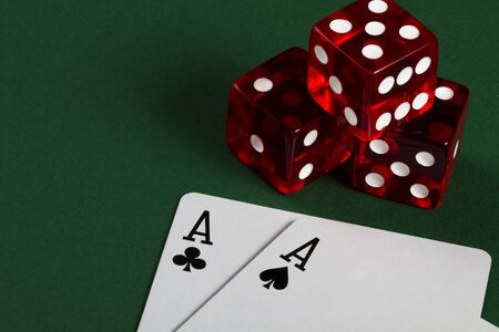 two aces and three dices on green background photo