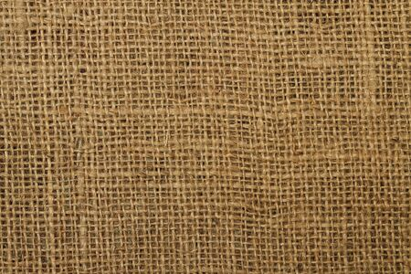 background texture of an ancient brown jute material photo