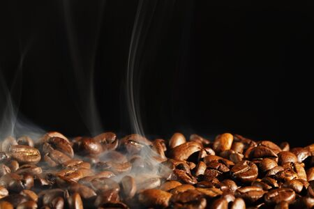 roasting coffe with smoke and black background photo