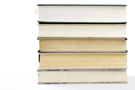 a stack of five books on white background photo