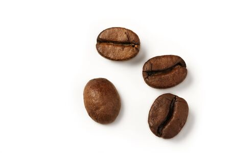 four coffee beans from top on white background