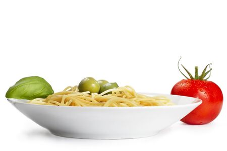 one plate with pasta some olives one tomato and basilikum Stock Photo - 7446888