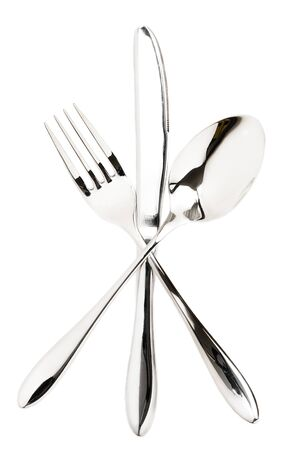 fork, spoon and a knife crossed on white background photo
