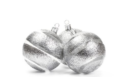 silver: three clear christmas balls with glitter stripes on white background Stock Photo