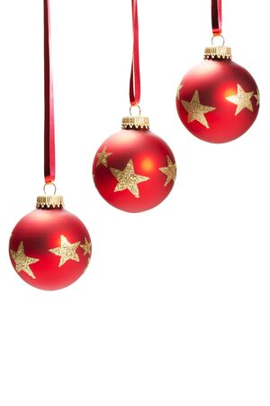 three hanging dull red christmas balls with golden glitter stars on white background Stock Photo - 7617413