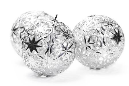 three metal christmas balls on white background