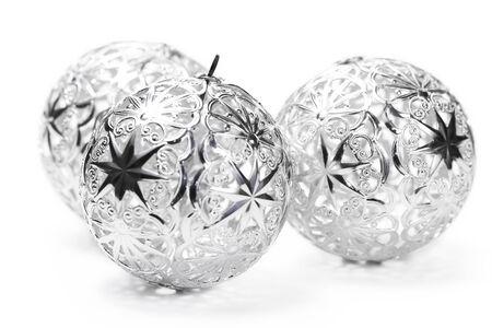 three metal christmas balls on white background