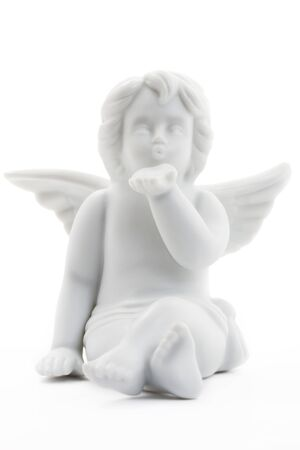 kissing white christmas angel figurine on white background