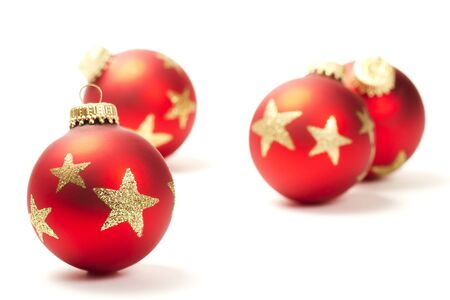 red christmas ball in front of others on white background