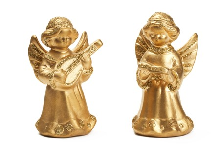 stock photo two golden christmas angel figurines as musicians on white background
