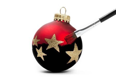red christmas ball gets his color with a brush on white background Stock Photo - 7676887