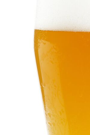 half wheat beer in a glass on white background