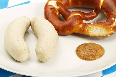 sweet mustard: bavarian veal sausages with pretzel and sweet mustard