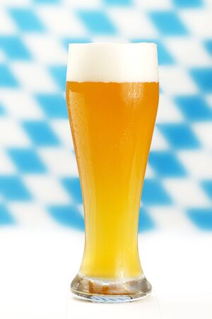 wheat beer with blue and white bavarian rhombus background Stock Photo - 7813904