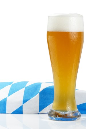 wheat beer with bavarian towel on white background