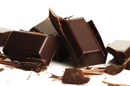 chocolate block: broken plain chocolate pieces on white background Stock Photo