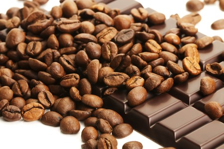 a lot of coffee beans on a plain chocolate bar photo