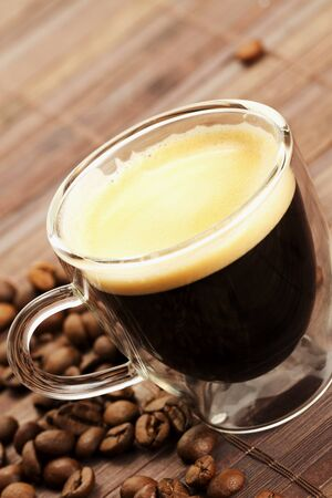 diagonal espresso with coffee beans on wooden background photo