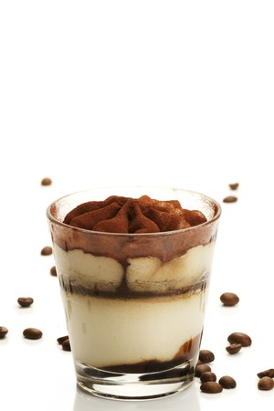 tiramisu: tiramisu in a glass with coffee beans on white background