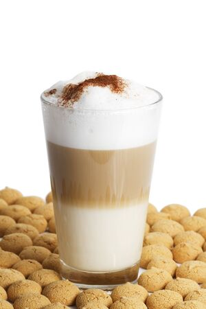 latte macchiato between a lot of amarettini on white background Stock Photo - 8083363