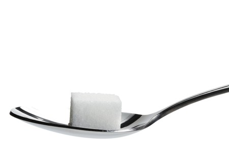 one lump sugar on a spoon isolated on white background Stock Photo