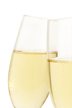 aslope glass of champagne behind other on white background photo