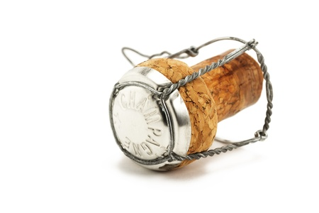 lying cork from a champagne bottle on white background Stock Photo