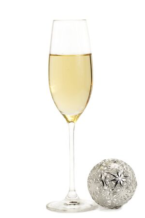 glass of champagne with a metal christmas ball on white background Stock Photo - 8337724