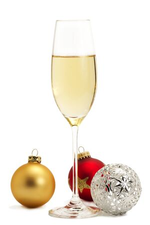 glass of champagne with golden, red and metal christmas balls on white background Stock Photo - 8337737