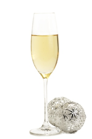 glass of champagne with two metal christmas balls on white background Stock Photo - 8337732