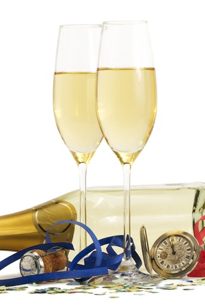 two glasses with champagne, old pocket watch, streamer, cork and confetti in front of a champagne bottle on white background Stock Photo - 8337793
