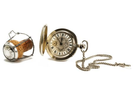 old pocket watch with a cork on white background photo