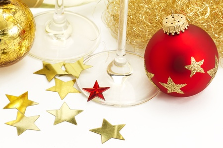 red and vintage christmas balls from top with angels hair, stars, champagne glass bottoms on white background photo