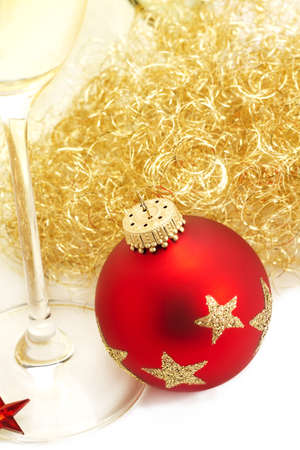 red christmas ball from top with angels hair and a champagne glass on white background Stock Photo - 8337831