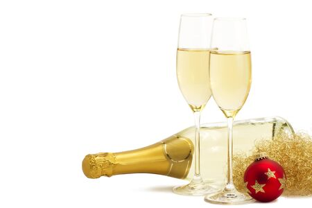 two glasses of champagne with angels hair, red christmas ball in front of a champagne bottle on white background Stock Photo - 8337744