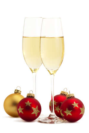 two glasses with champagne with one golden and three red christmas balls on white background Stock Photo - 8337730