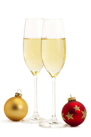 two glasses with champagne and one red and one golden christmas balls on white background Stock Photo - 8337720