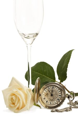 creamy rose with a old pocket watch and a empty champagne glass on white background photo