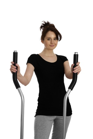 young woman exercising on stepping machine photo