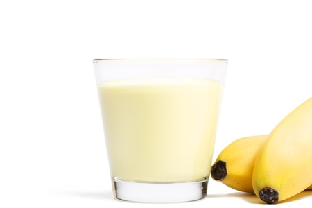 banana milkshake with bananas aside on white background