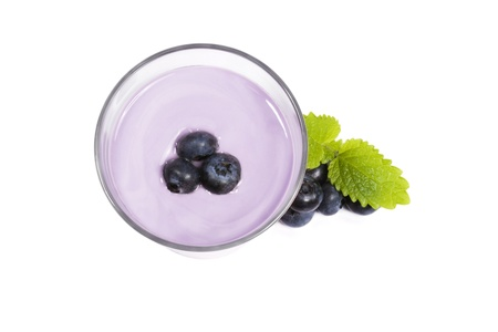 blueberries on top of a blueberry milkshake with blueberries and melissa aside on white background Stock Photo