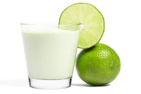 aside: lime blade on a milkshake and lime aside on white background