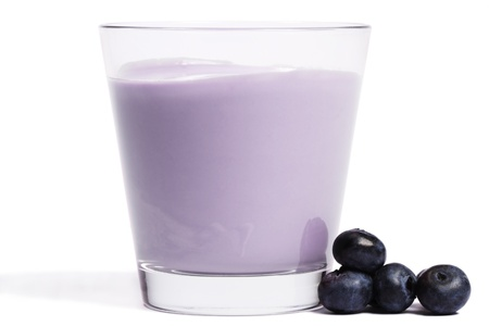 some blueberries near a milkshake on white background Stock Photo