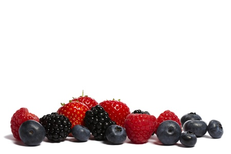 blueberries, strawberries blackberries and raspberries on white background Stock Photo