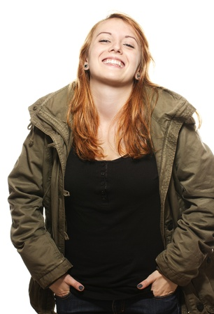 parka: happy young redhead woman in parka on white background