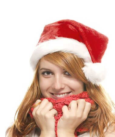 portrait of a happy young redhead woman with santas hat on white background photo