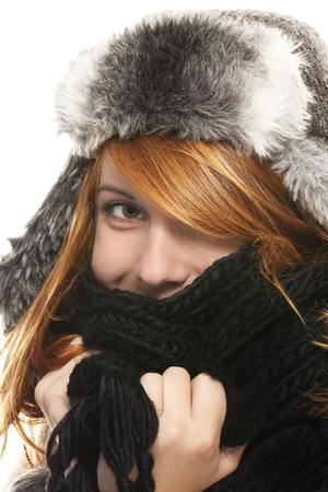freckled: young redhead woman covering in muffler on white background Stock Photo