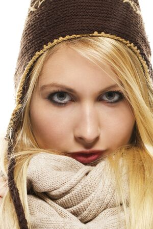 beautiful blonde woman in winter dress on white background photo